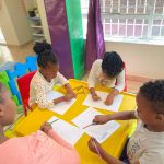 Children writing in class
